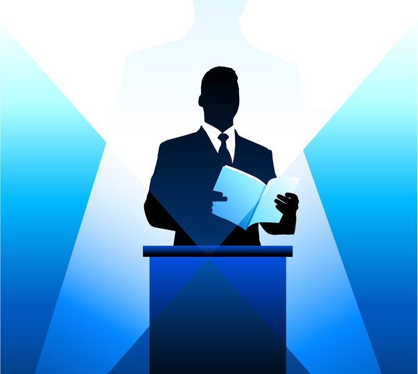 Business/political speaker silhouette background